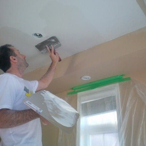Scrapping ceiling stucco off