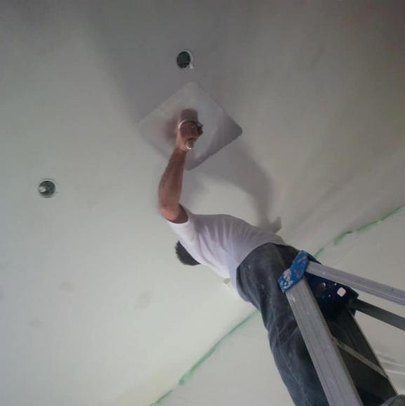 Ceiling repair in action in Milton