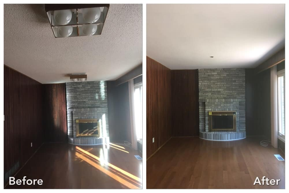 Living room with fire place smooth ceiling